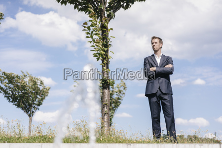 businessman standing on a field with