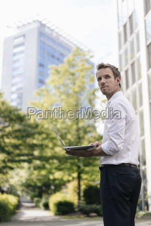 businessman using laptop in front of