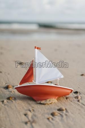 toy boat an the beach