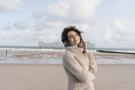 smiling woman on the beach with