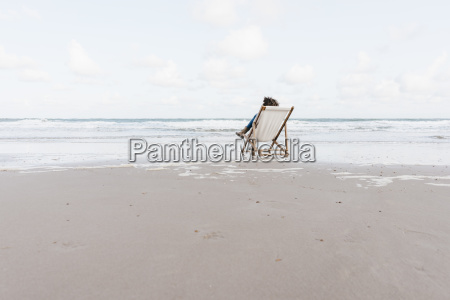 woman sitting on deckchair on the