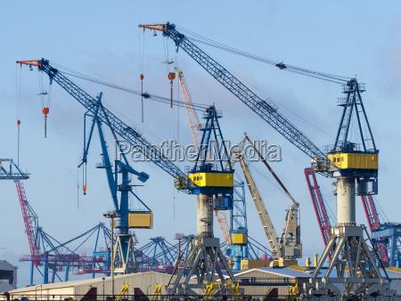 germany hamburg cranes at the harbor