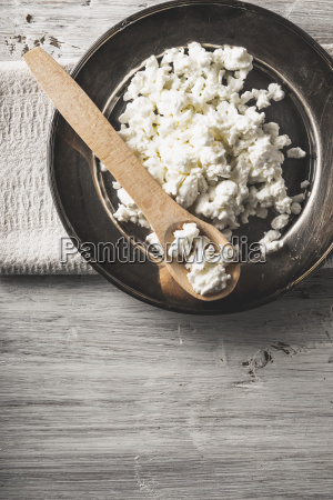 fresh cottage cheese on the metal