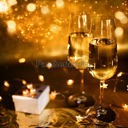 golden bokeh background with champagne