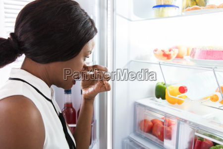 woman holding her nose near foul