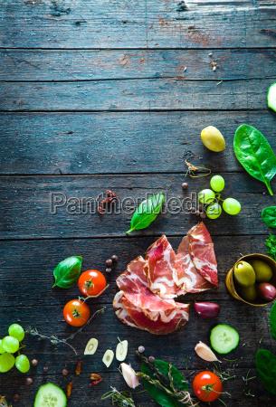 italian ham on wood