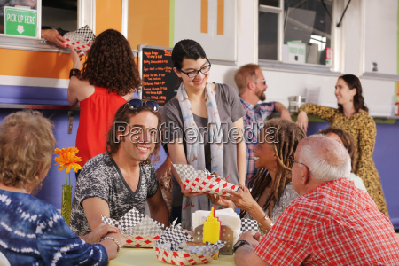 man has lunch with senior friends