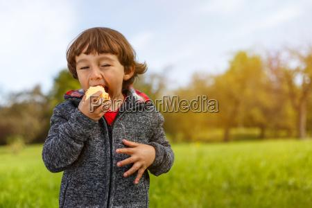 child apple fruit fruits eat outdoors