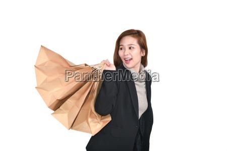 beautiful asian woman with shopping bags
