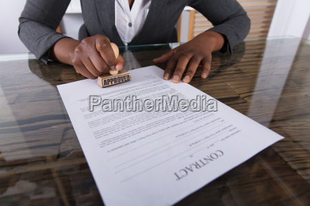 persons hand stamping on approved contract