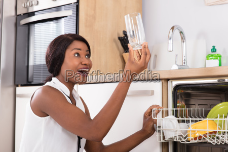 woman holding drinking glass