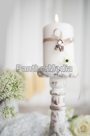 wedding rings with candle