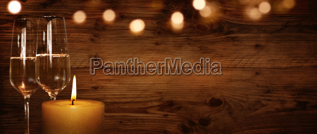 rustic background with candle and champagne