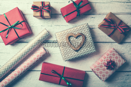 packed gifts and wrapping paper on