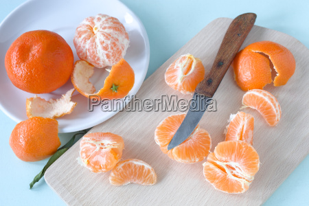 mandarin oranges and knife on a