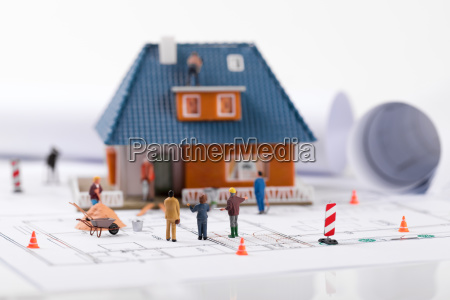construction manager showing new house building