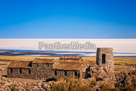 old building on the shore of