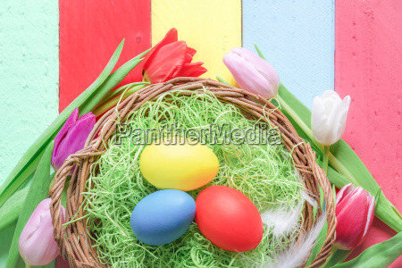 easter basket and multicolor tulips
