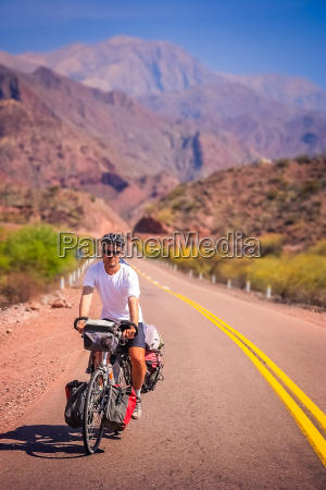 man cycling on the empty road
