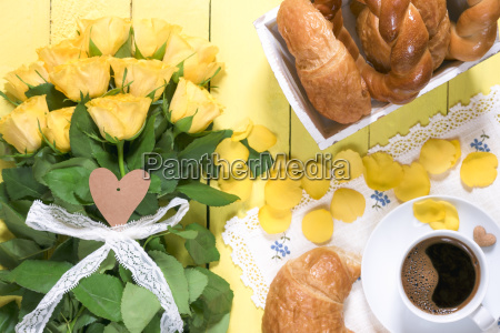 breakfast table and yellow roses