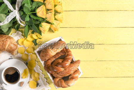 coffee with pastry products and roses