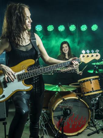 beautiful women playing in the rock