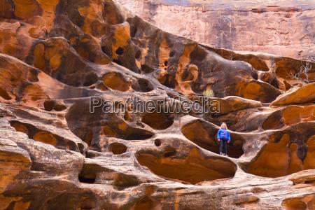 little girl standing in eroded sandstone