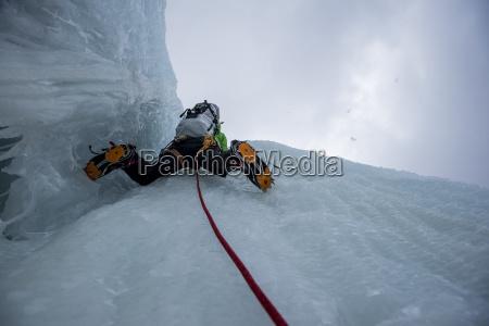 directly below view of man climbing