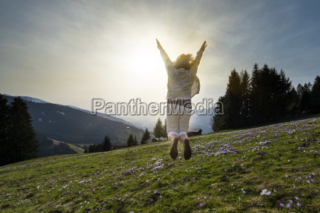 austria tyrol young woman jumping on