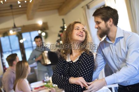 young couple dancing on a christmas