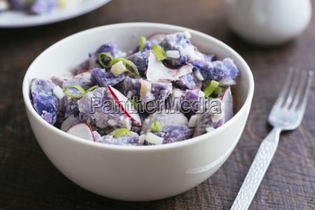 purple potato salad with radishes