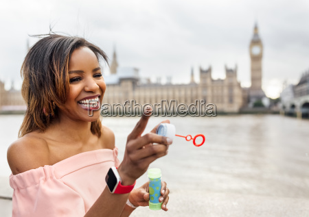 uk london happy woman making soap
