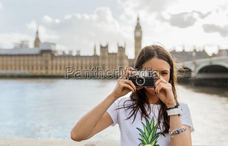 uk london beautiful woman taking a