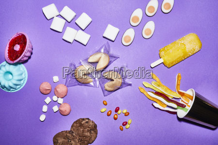 different sorts of sweets on purple