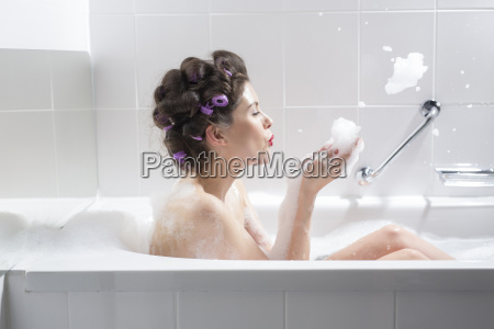 young woman with curlers taking a