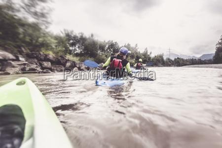 germany bavaria allgaeu kayakers on river