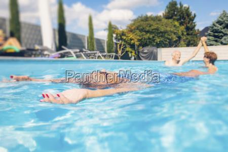 seniors swimimng in swimming pool