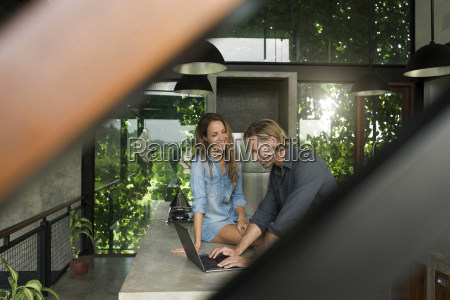 woman smiling at husband with laptop