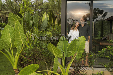 garden view of smiling couple looking