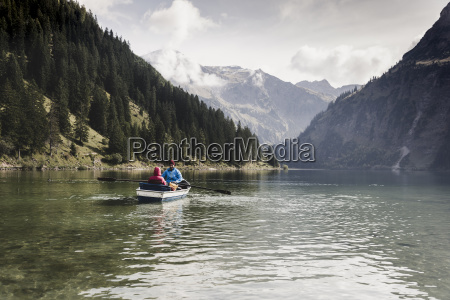 austria tyrol alps couple in rowing
