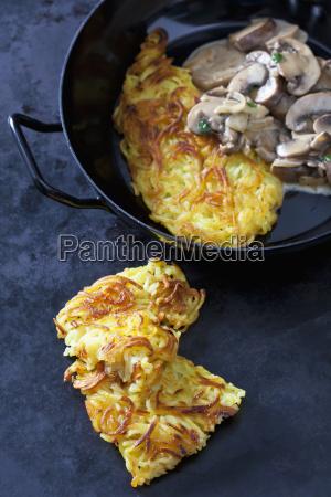 potato rostis with champignons in cream