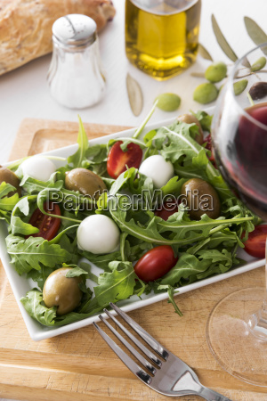 rocket salad with olive tomato and