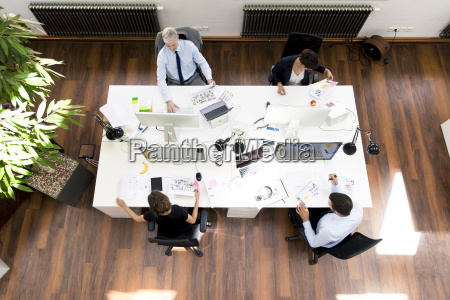 business people in planning office sitting