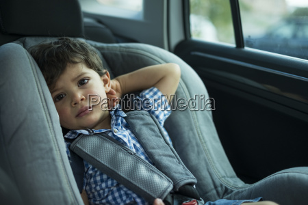 portrait of toddler sitting in childs