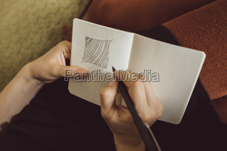 hand of woman on couch drawing