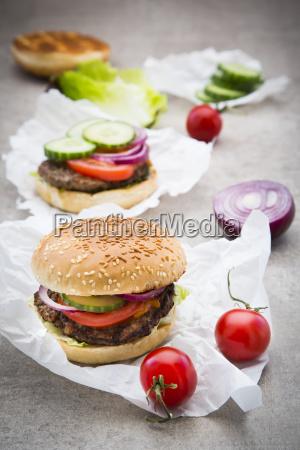 homemade burger tomato red onion salad