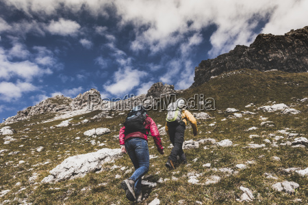 germany bavaria oberstdorf two hikers walking