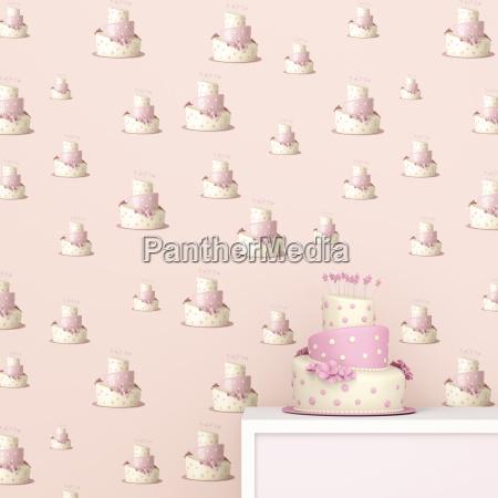 rosa und weisser geburtstagskuchen vor tapete