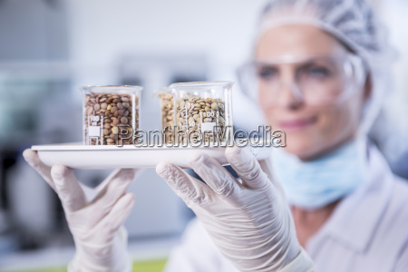 scientist in lab holding tray with