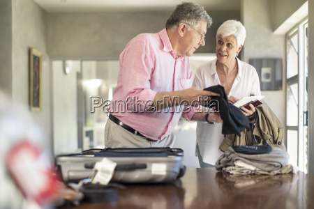 senior couple packing for a trip